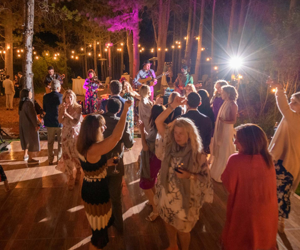 Lake Tahoe wedding on Truckee River - guests dancing