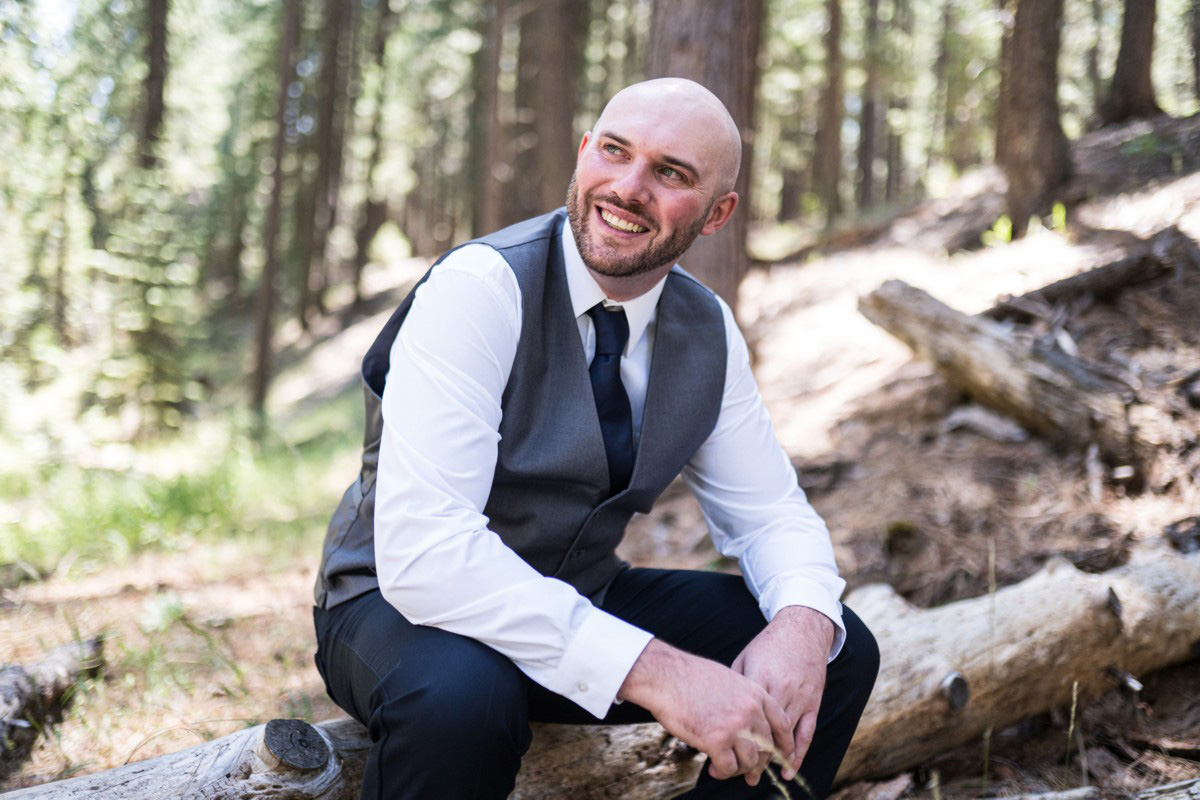 Forest Wedding near Lake Tahoe - groom relaxing before ceremony