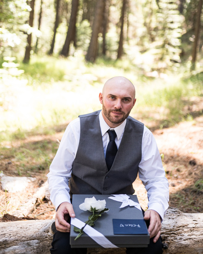 Forest Wedding near Lake Tahoe - groom opening gift from bride