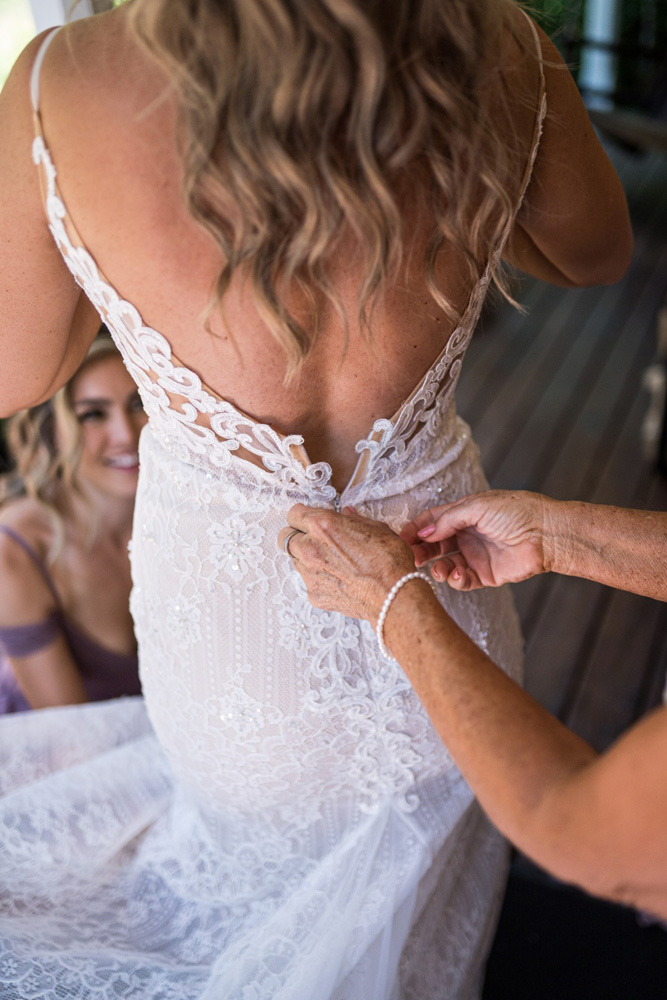 Forest Wedding near Lake Tahoe - bride getting into dress