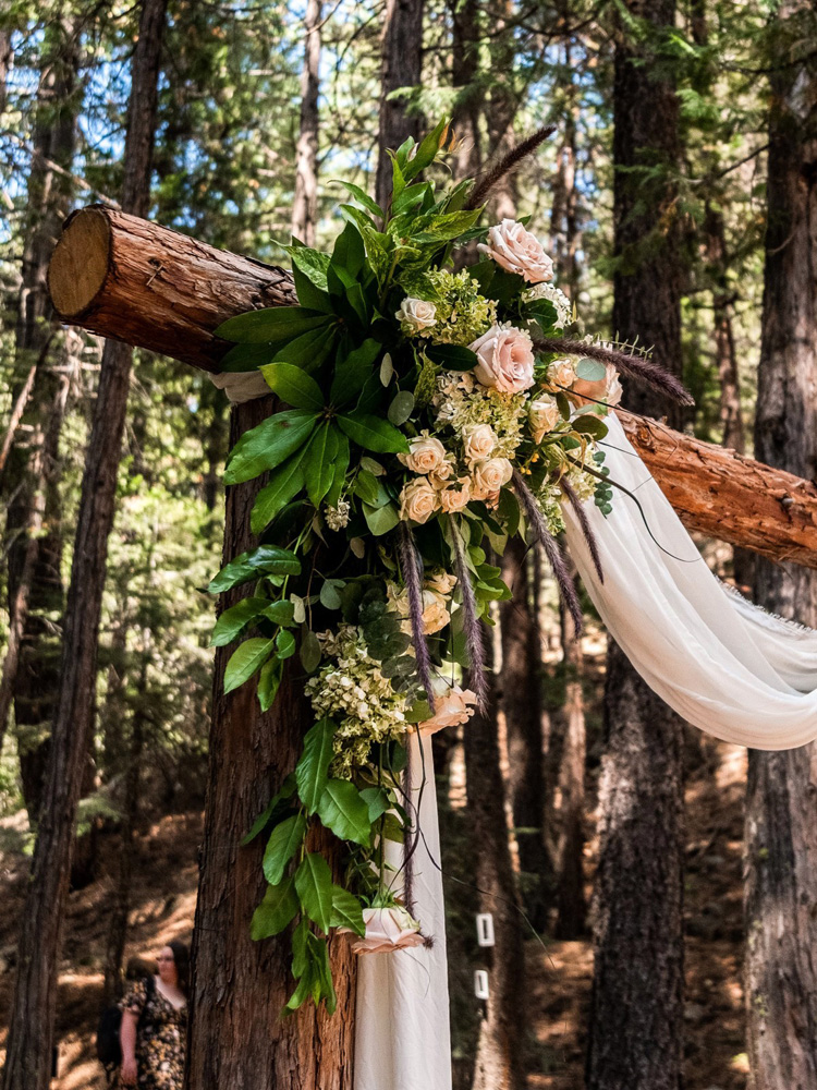 Forest Wedding near Lake Tahoe - ceremony structure flowers
