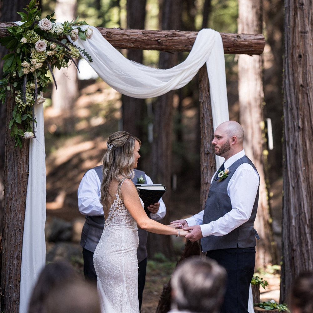 Forest Wedding near Lake Tahoe - couple holding hands during ceremony
