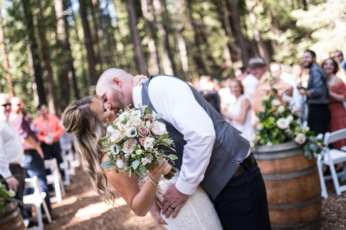 Forest Wedding near Lake Tahoe - another kiss after walking down the aisle