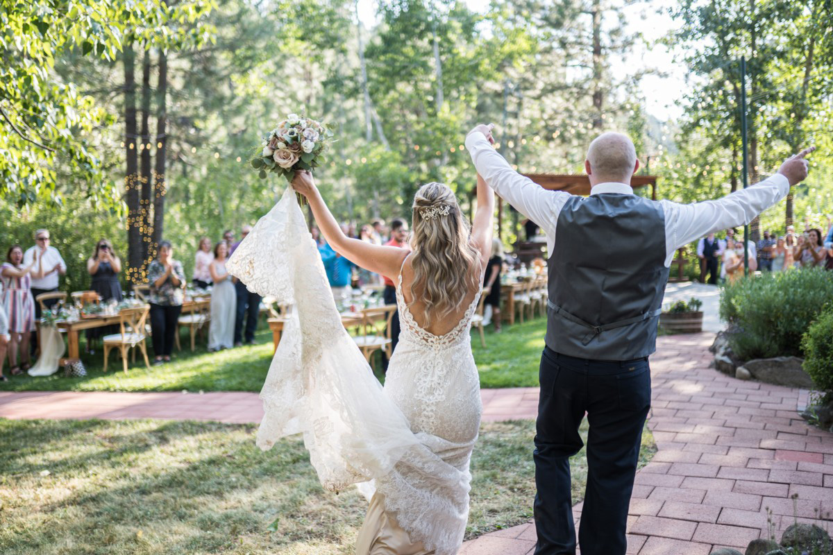 Forest Wedding near Lake Tahoe - couple make grand entrance to reception