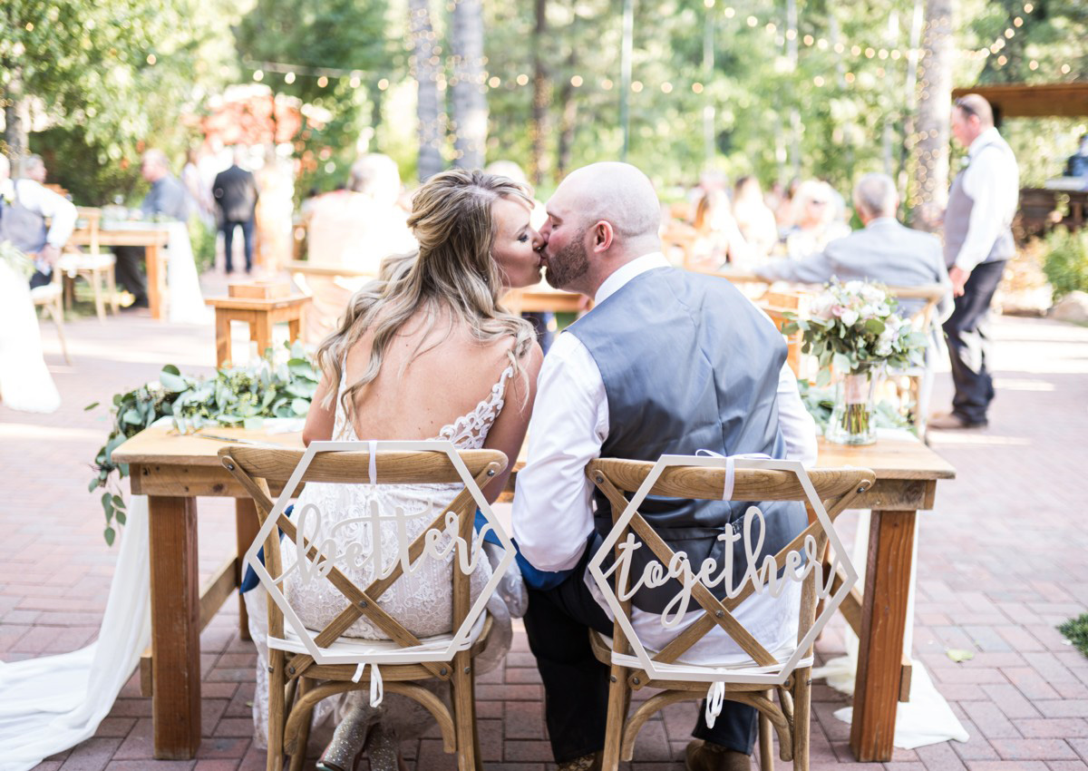 Forest Wedding near Lake Tahoe - couple kissing at sweetheart table
