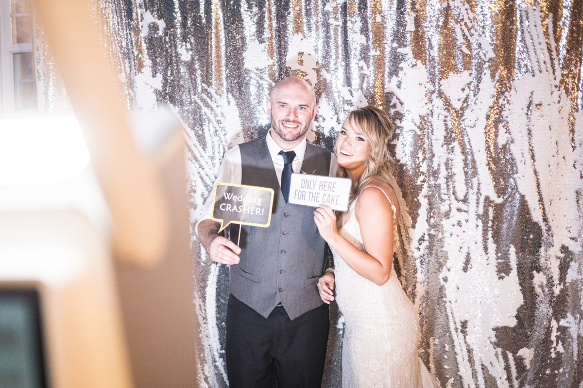 Forest Wedding near Lake Tahoe - couple posing in photo booth