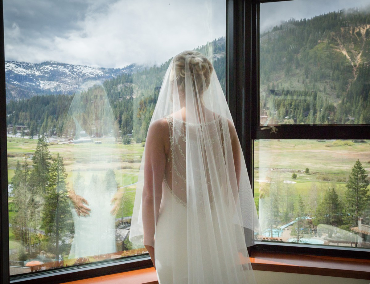 Resort at Squaw Creek Lake Tahoe wedding - bride admiring scenery
