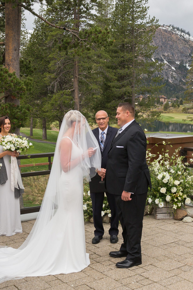Resort at Squaw Creek Lake Tahoe wedding - bride reading vows