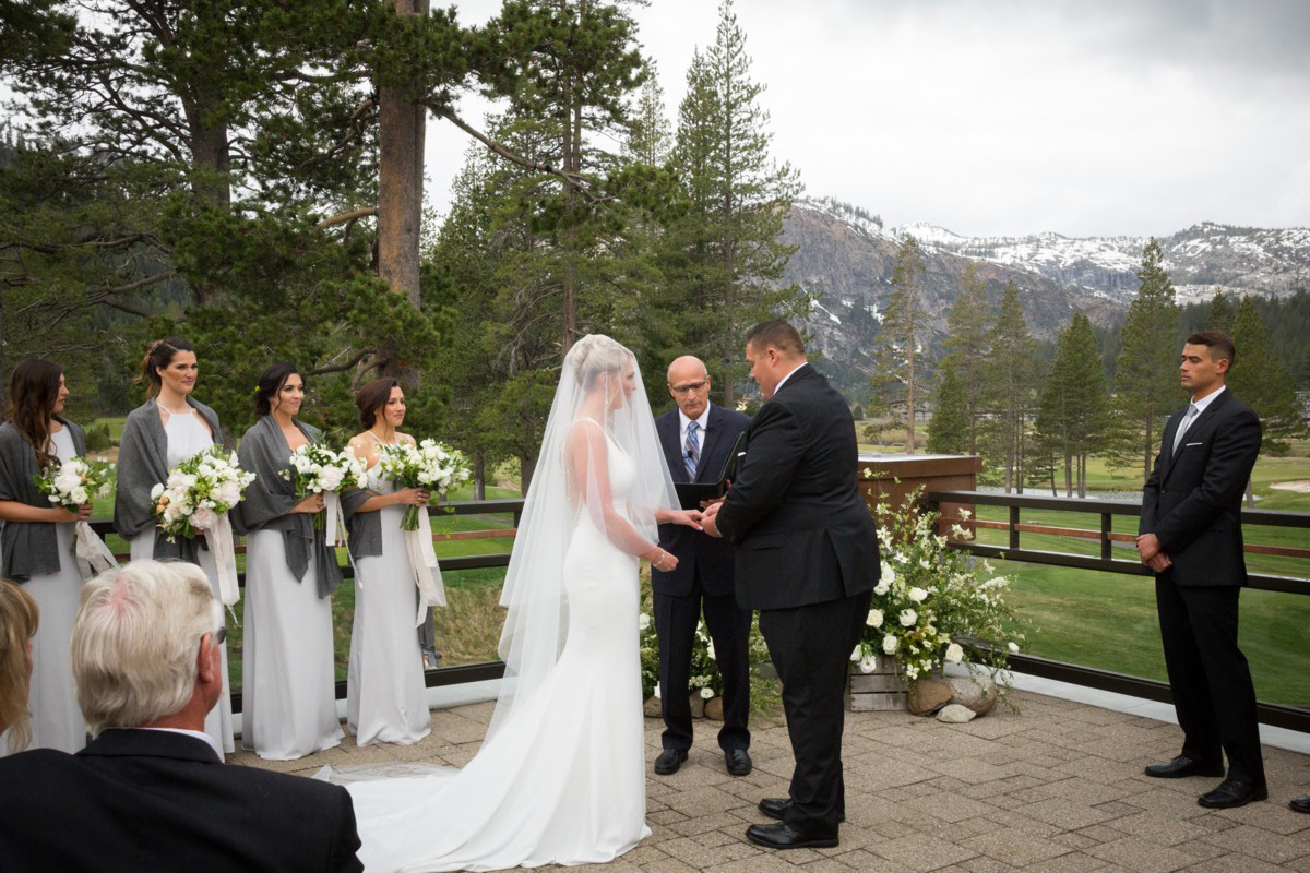 Resort at Squaw Creek Lake Tahoe wedding - groom putting ring on bride