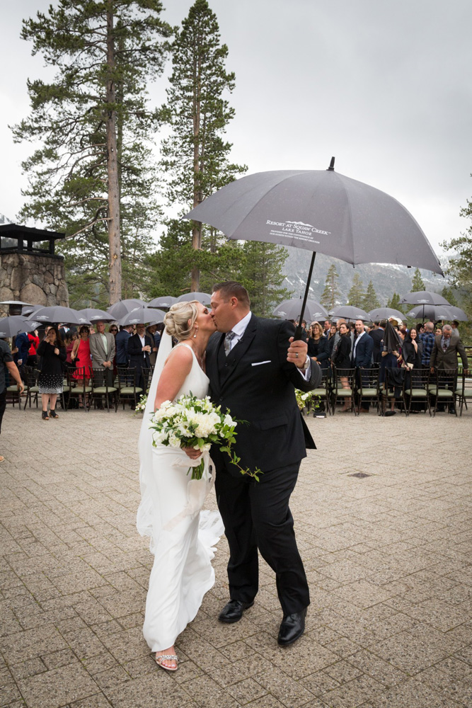 Resort at Squaw Creek Lake Tahoe wedding - groom with umbrella