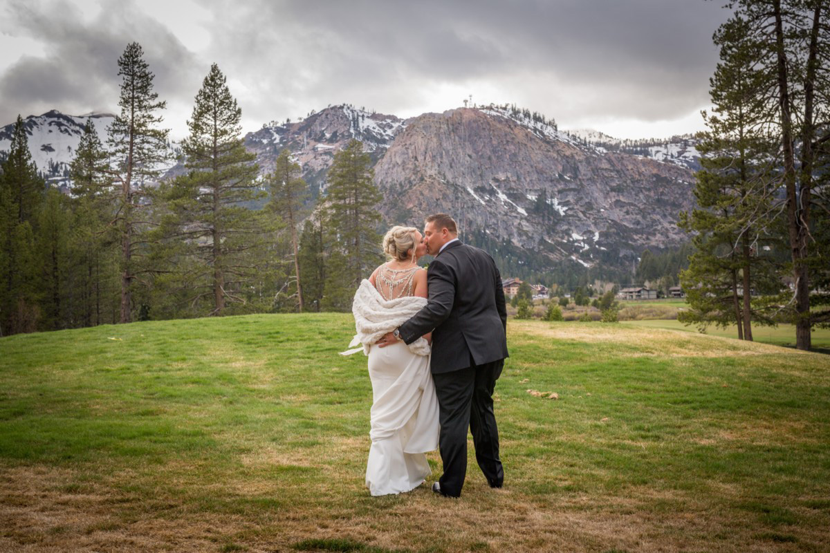 Resort at Squaw Creek Lake Tahoe wedding - couple with mountains