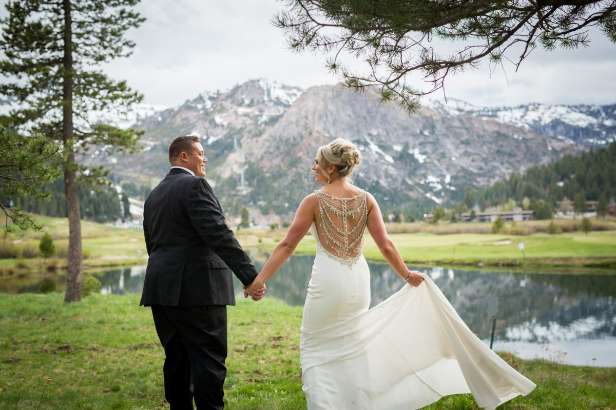 Resort at Squaw Creek Lake Tahoe wedding - couple by pond and mountains