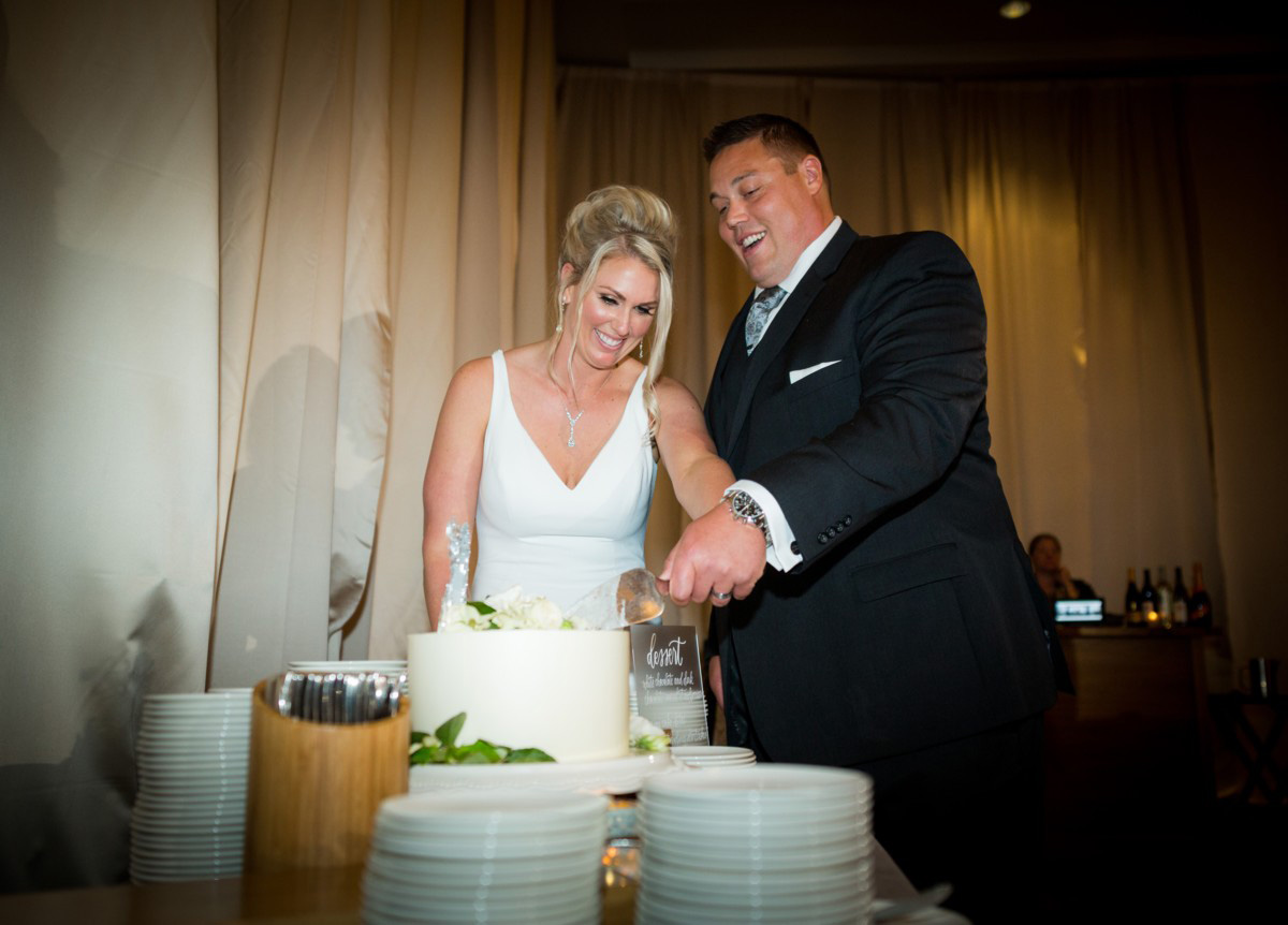 Resort at Squaw Creek Lake Tahoe wedding - couple cutting cake