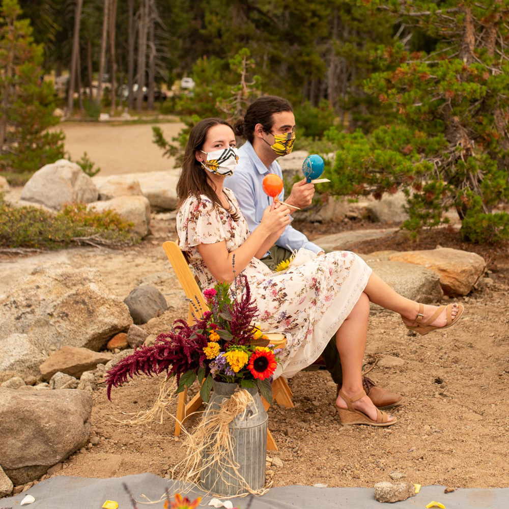 guests wearing custom masks at socially distanced wedding ceremony at the HideOut near Lake Tahoe