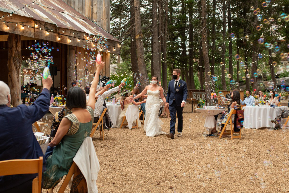 wedding couple makes a grand entrance at their socially distanced reception at the HideOut near Lake Tahoe