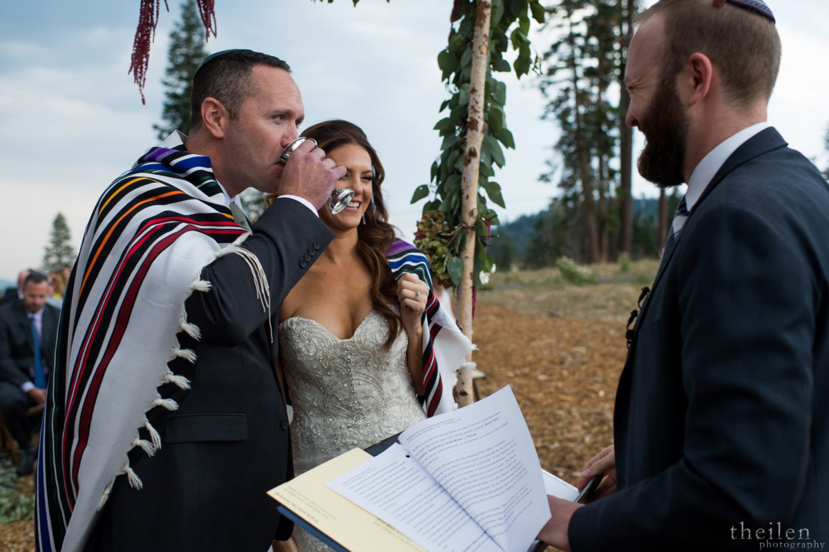 Northstar California Lake Tahoe wedding groom drinking from Jewish Kiddush cup