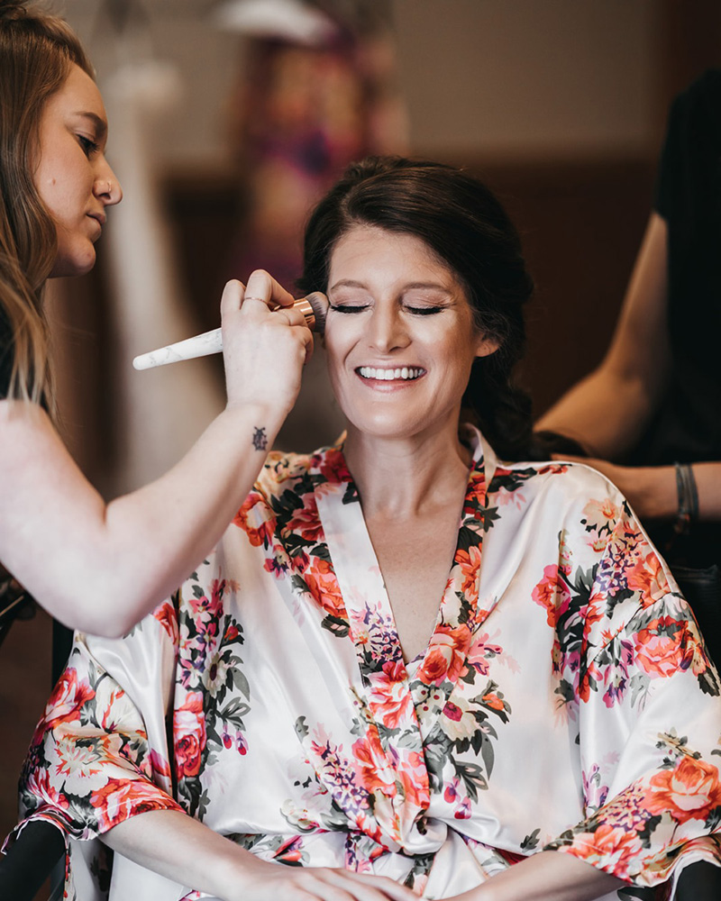 rustic relaxed wedding Lake Tahoe - bride having makeup done