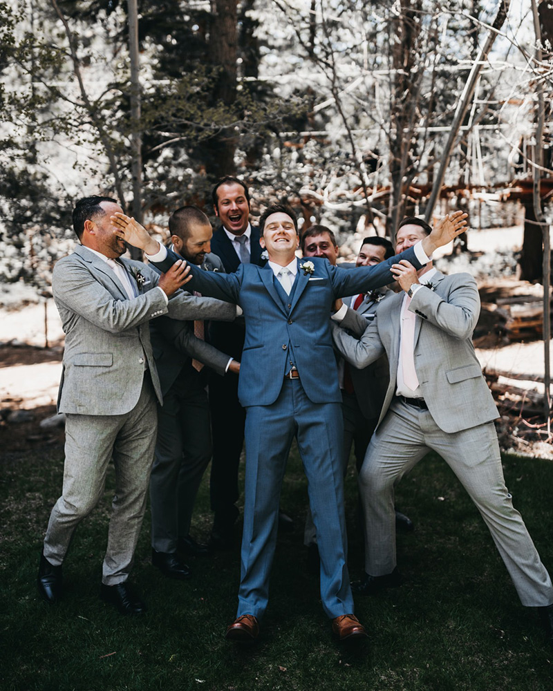 rustic relaxed wedding Lake Tahoe - groom having fun with groomsmen