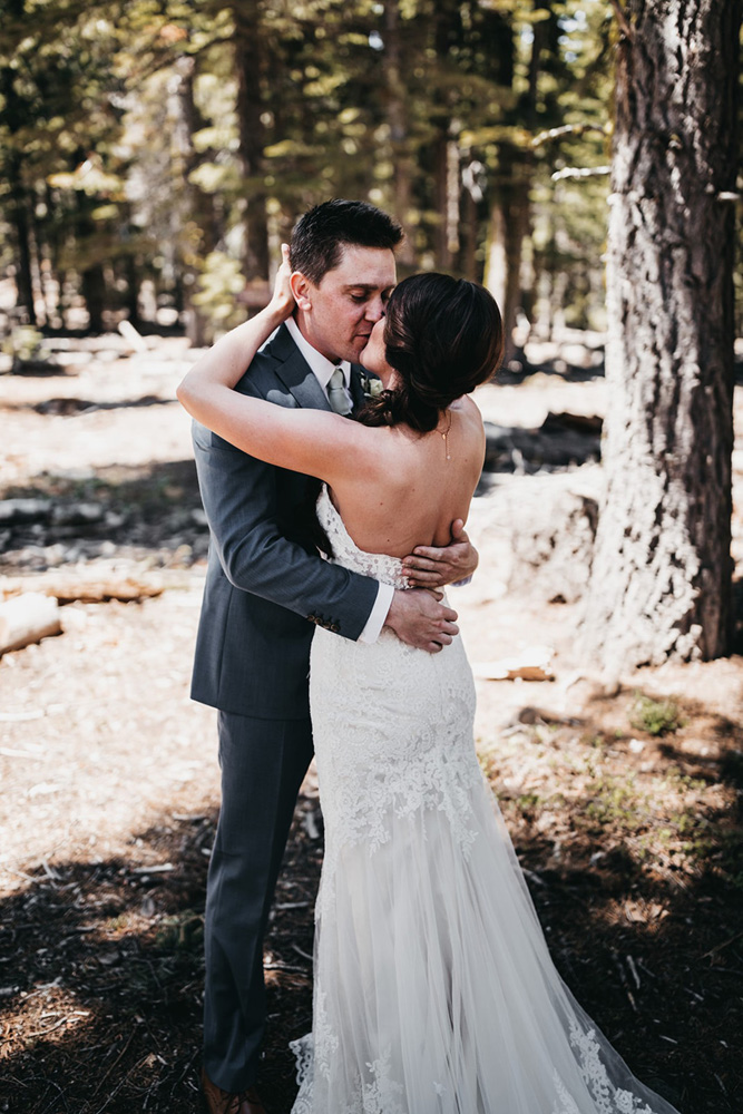 rustic relaxed wedding Lake Tahoe - couple kissing at first look
