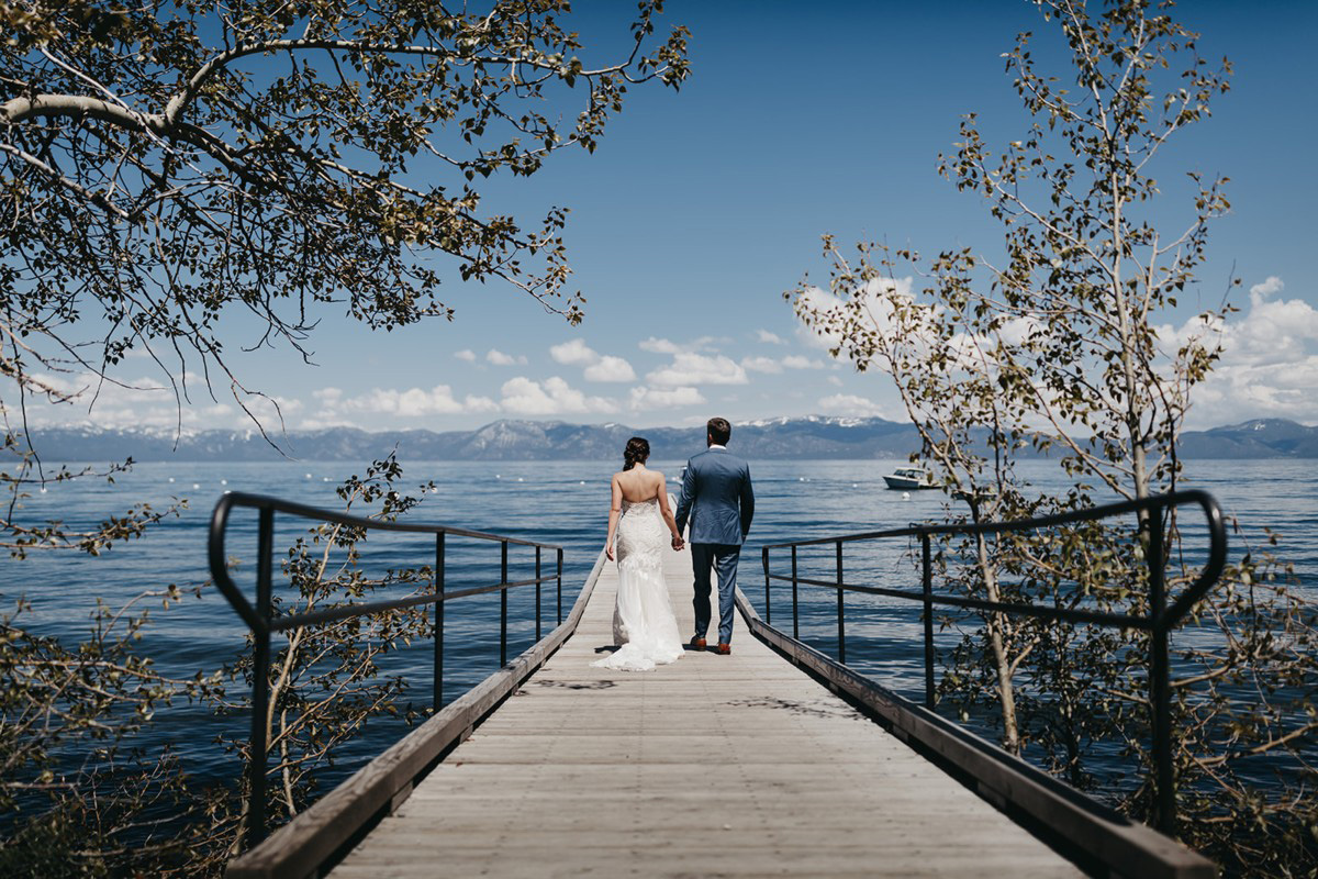 rustic relaxed wedding Lake Tahoe - couple walking on pier