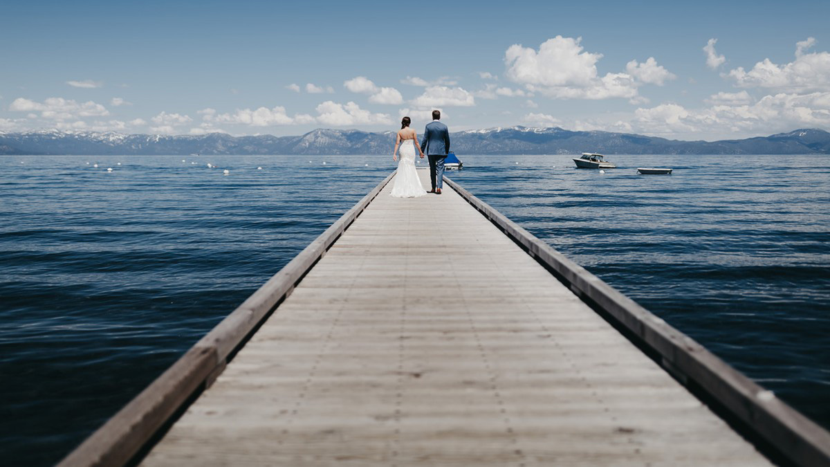 rustic relaxed wedding Lake Tahoe - couple quiet time on pier