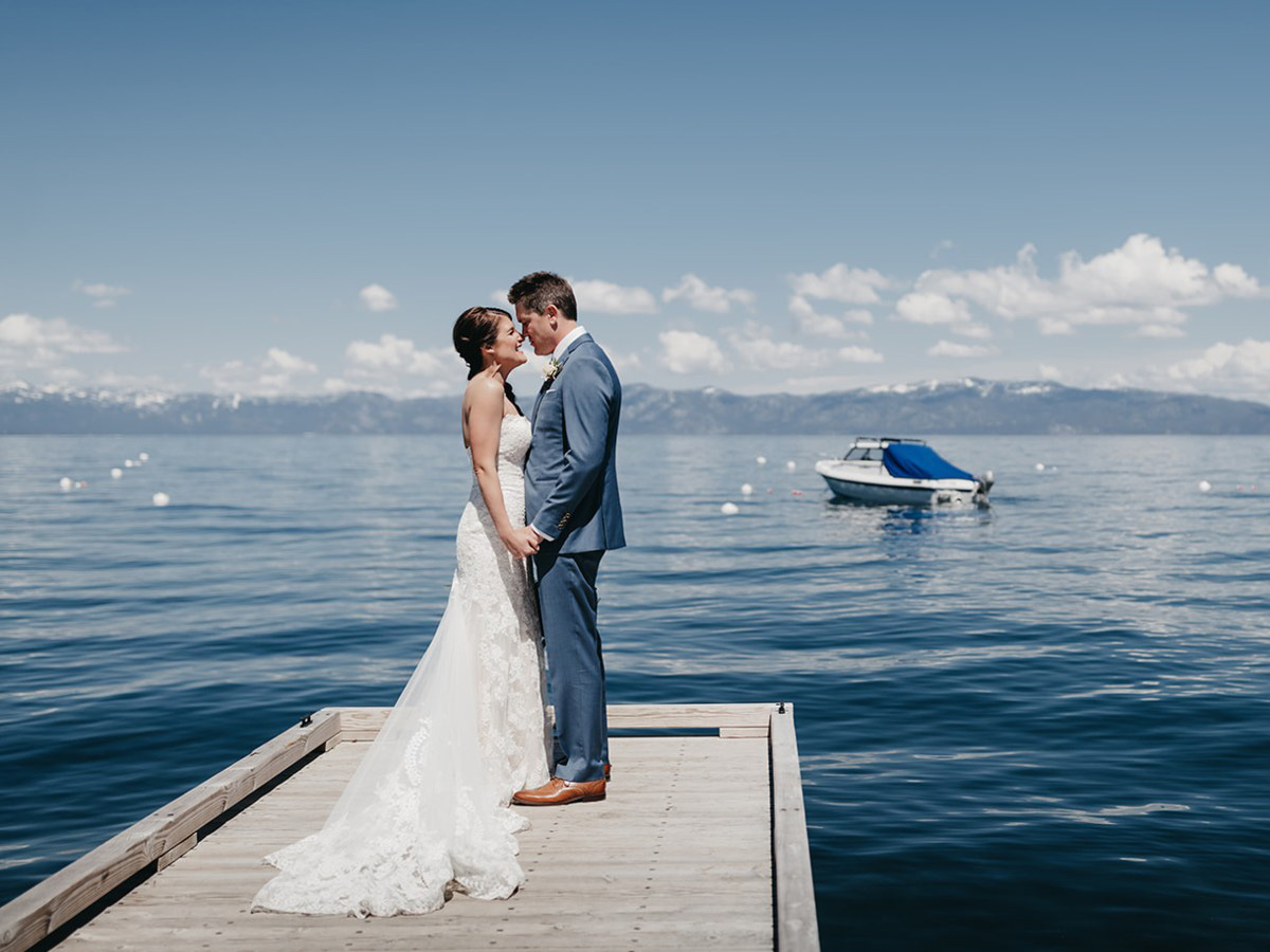 rustic relaxed wedding Lake Tahoe - couple by water on pier