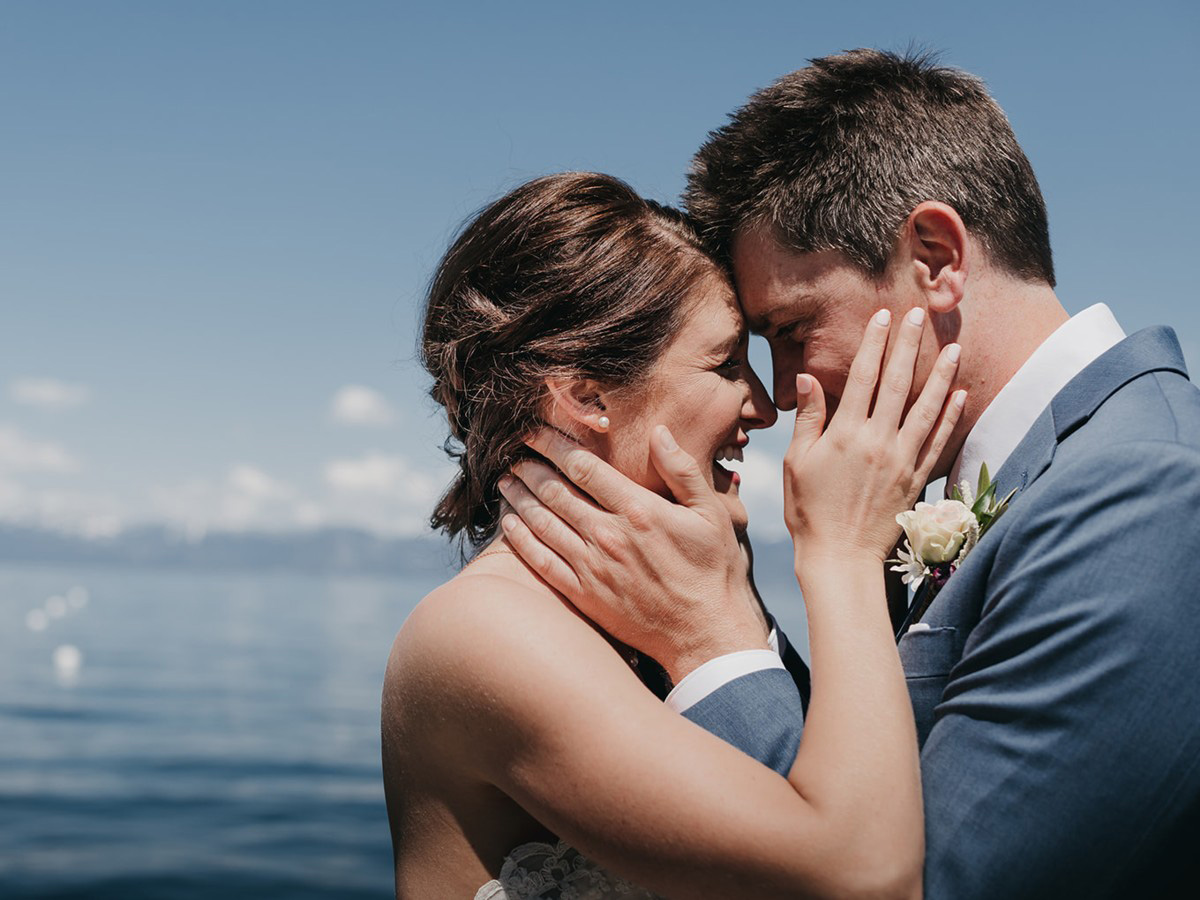 rustic relaxed wedding Lake Tahoe - couple embracing by lake