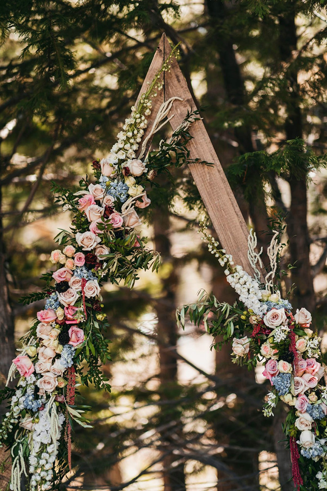 rustic relaxed wedding Lake Tahoe - ceremony structure with flowers