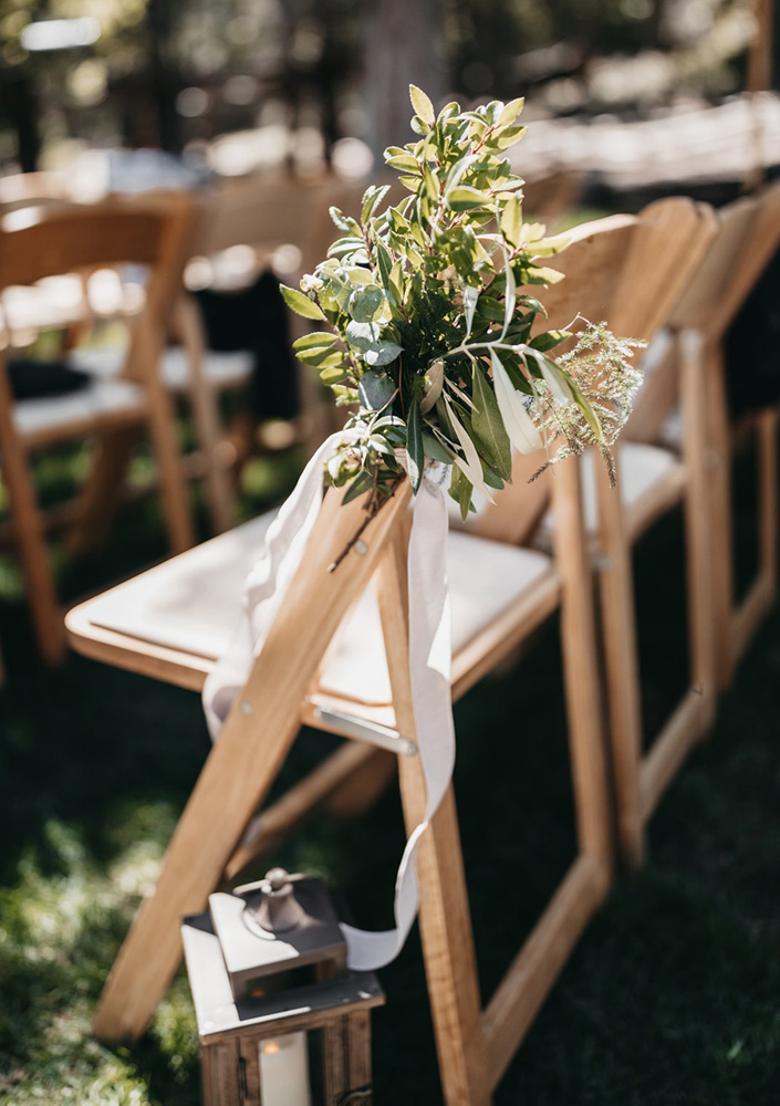rustic relaxed wedding Lake Tahoe - ceremony chairs with flowers