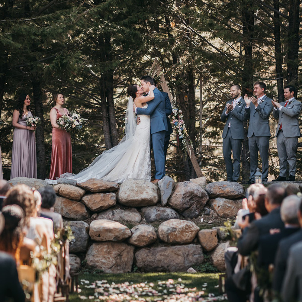 rustic relaxed wedding Lake Tahoe - couple kissing at end of ceremony