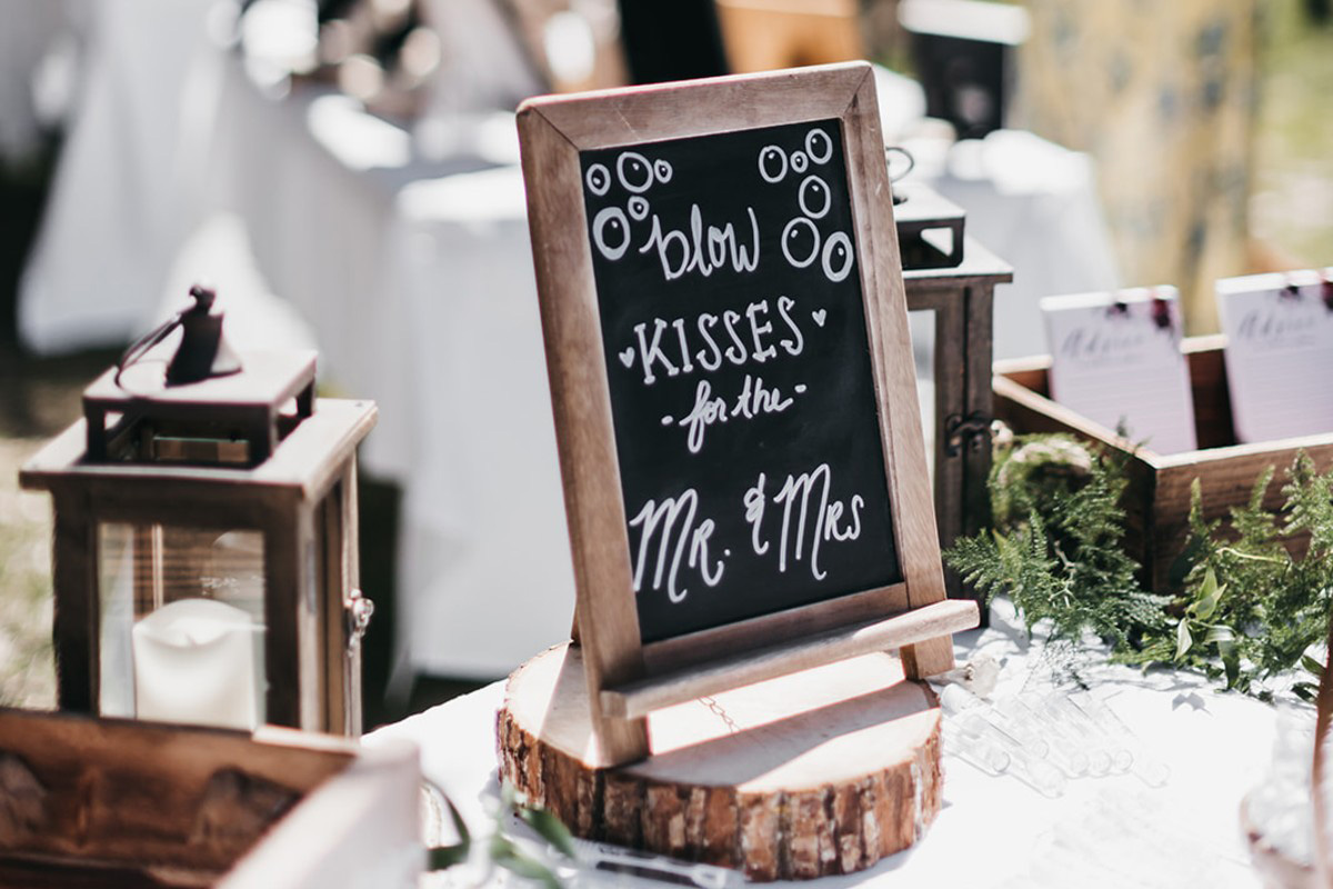 rustic relaxed wedding Lake Tahoe - sign asking guests to blow bubbles
