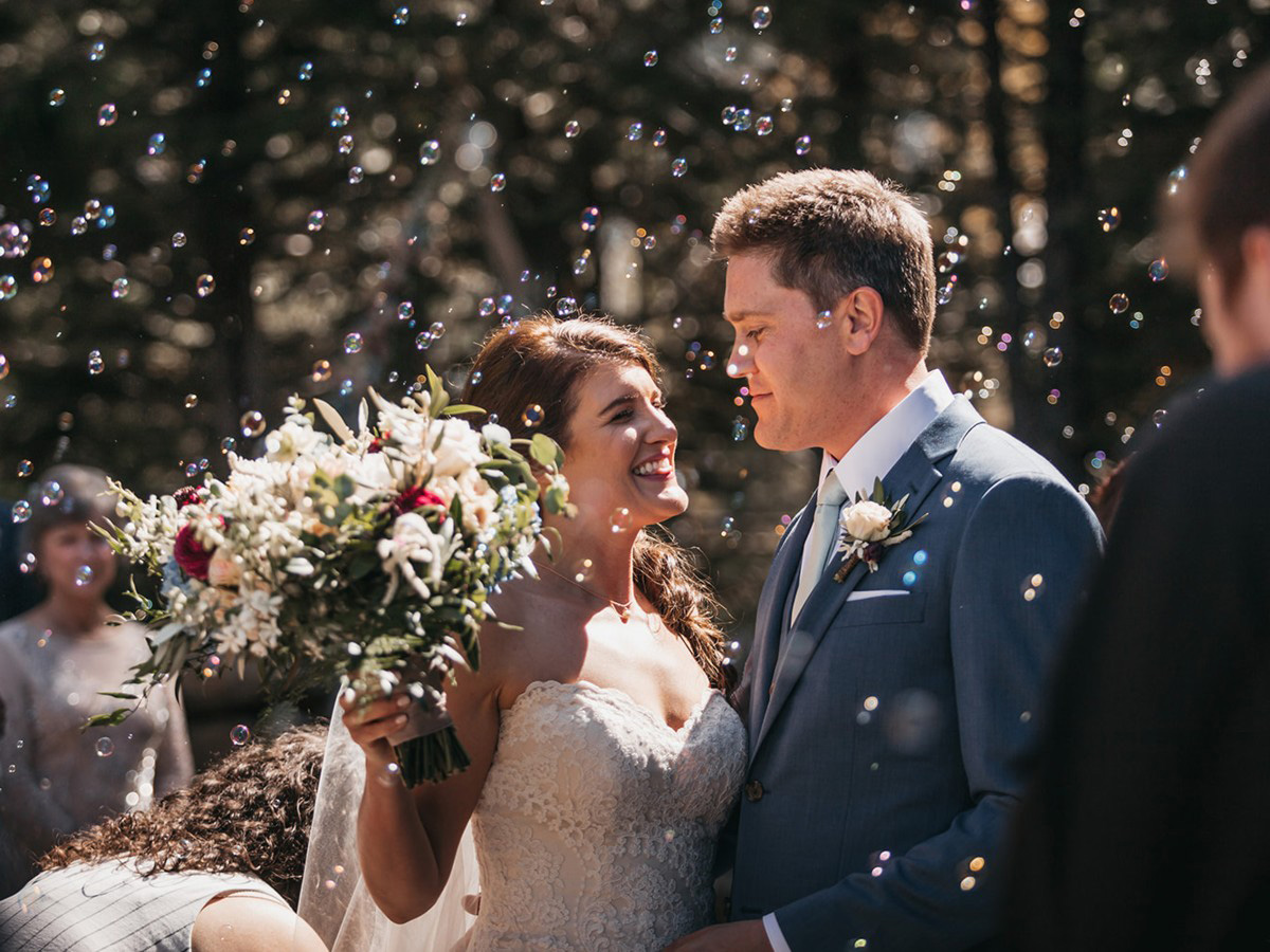 rustic relaxed wedding Lake Tahoe - newlyweds with bubbles