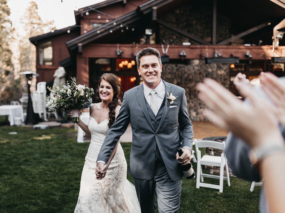 rustic relaxed wedding Lake Tahoe - couple makes grand entrance at reception