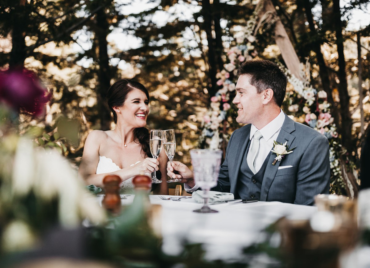 rustic relaxed wedding Lake Tahoe - couple toasting each other