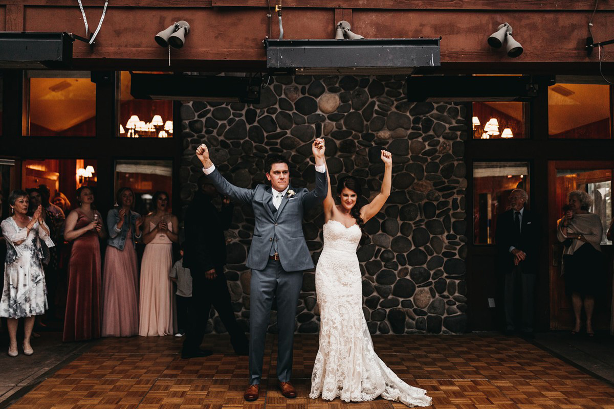 rustic relaxed wedding Lake Tahoe - cheers after end of first dance