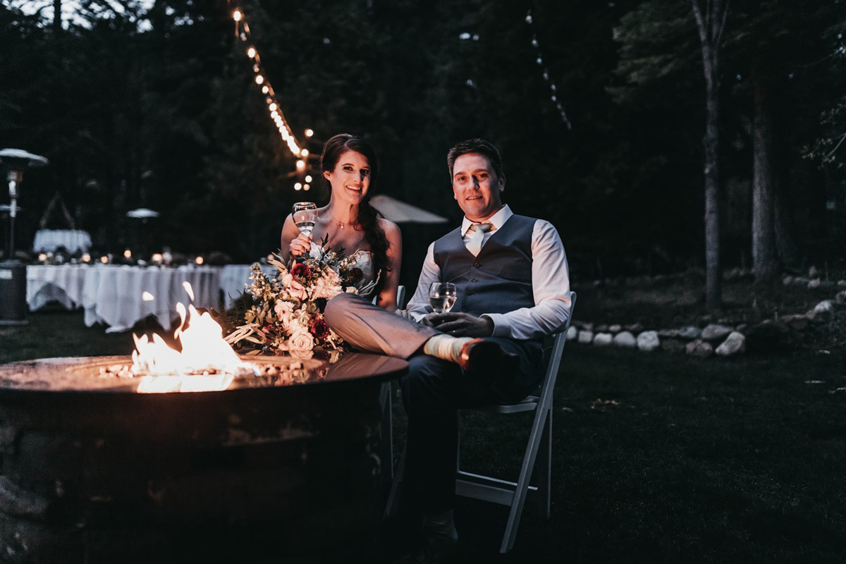 rustic relaxed wedding Lake Tahoe - couple relaxing by fire pit