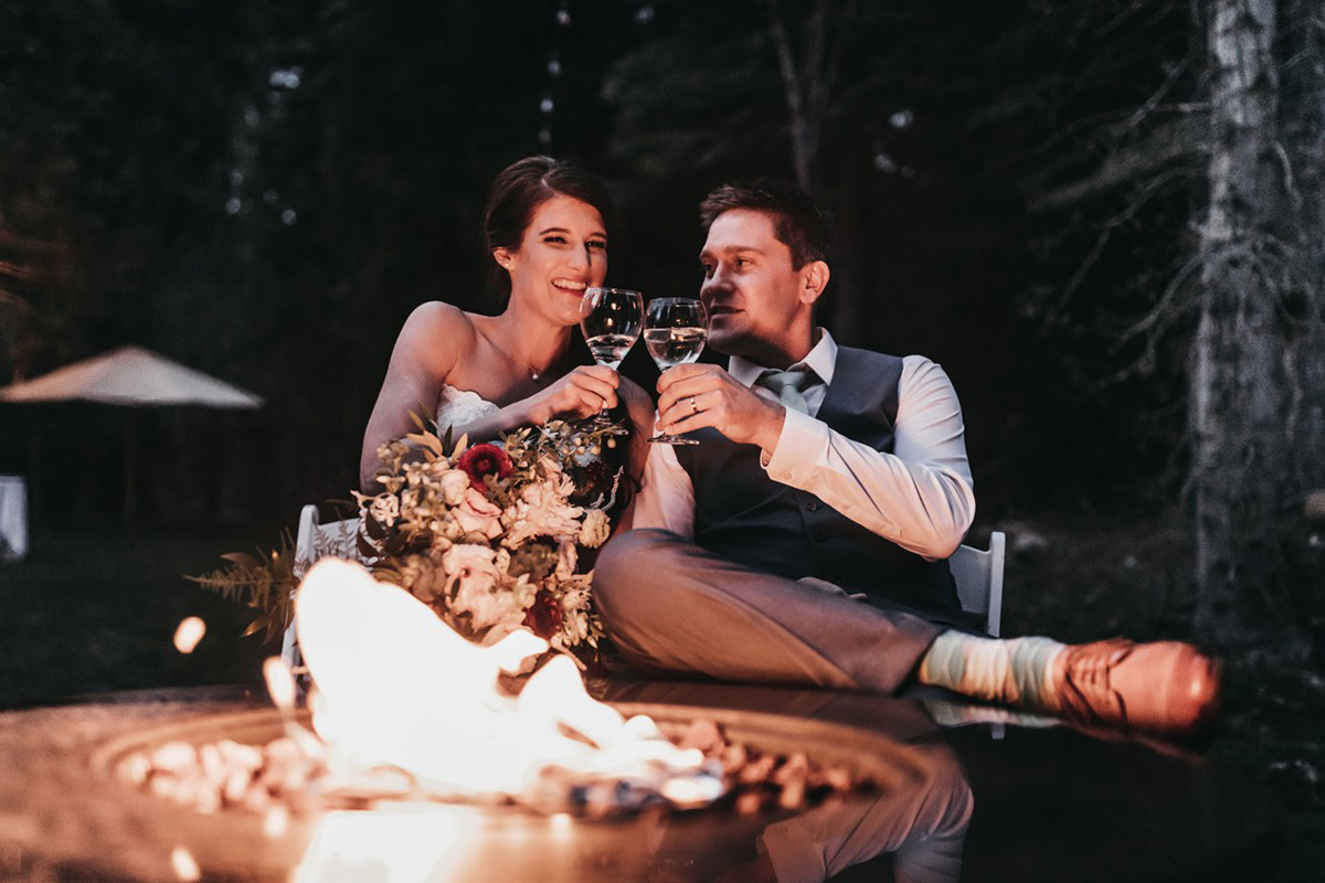 rustic relaxed wedding Lake Tahoe - couple toasting by fire pit