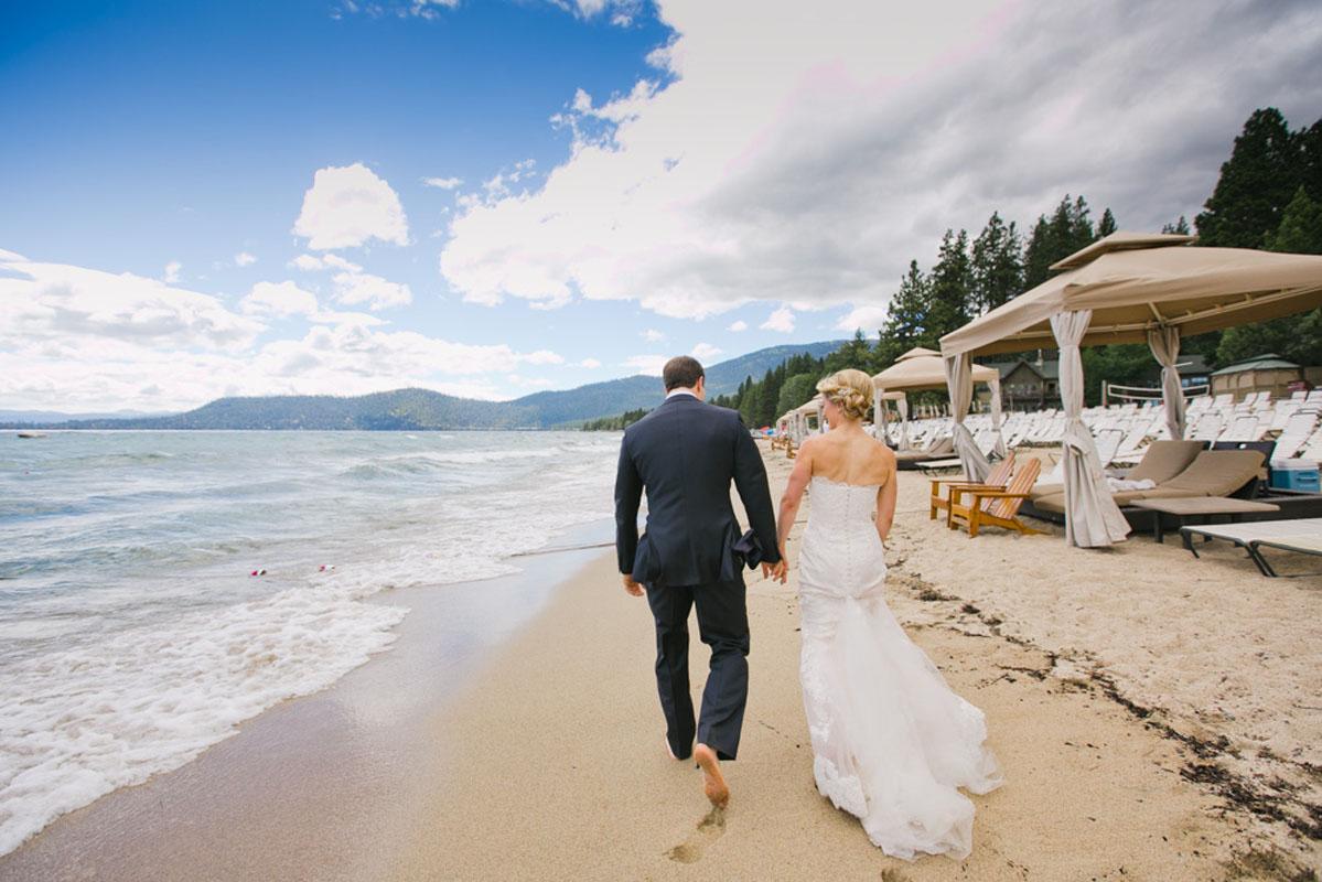 Couple walking on beach Lake Tahoe wedding