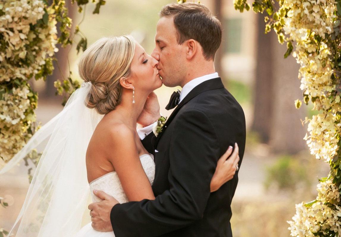 couple kissing wedding ceremony Lake Tahoe