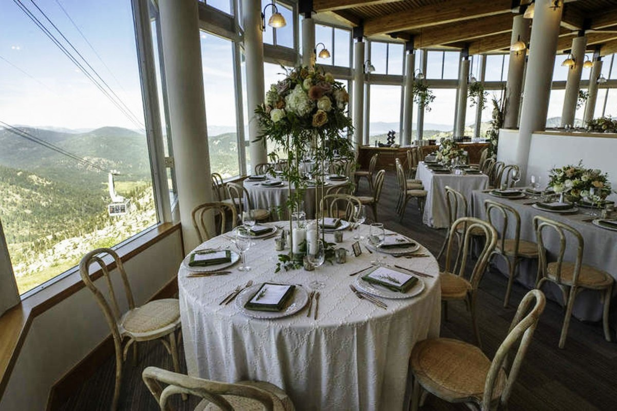 Lake Tahoe wedding Squaw Valley - dining tables at High Camp with tall centerpiece