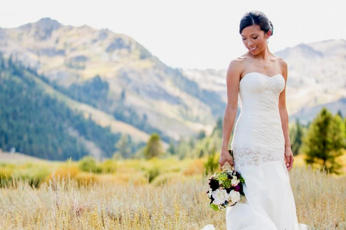 Lake Tahoe wedding Squaw Valley - bride in meadow with bouquet