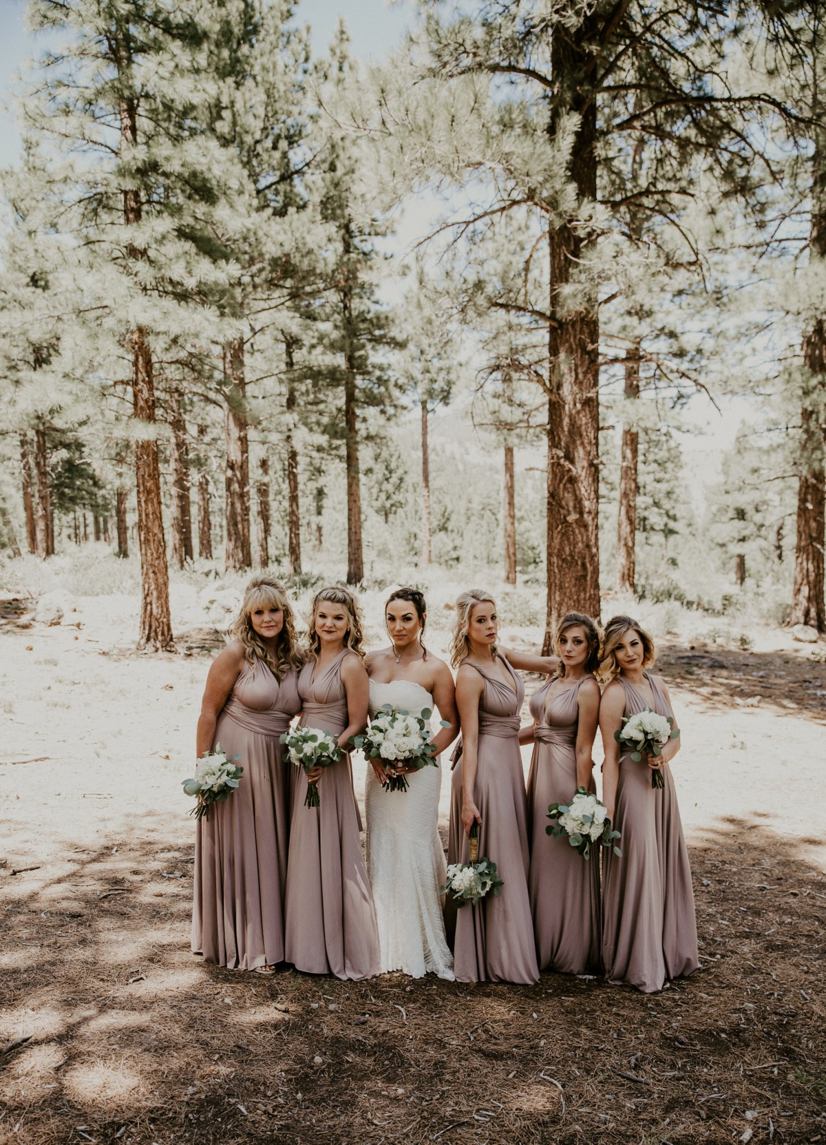 Tannenbaum by Roundabout Lake Tahoe wedding - bridal party in snow