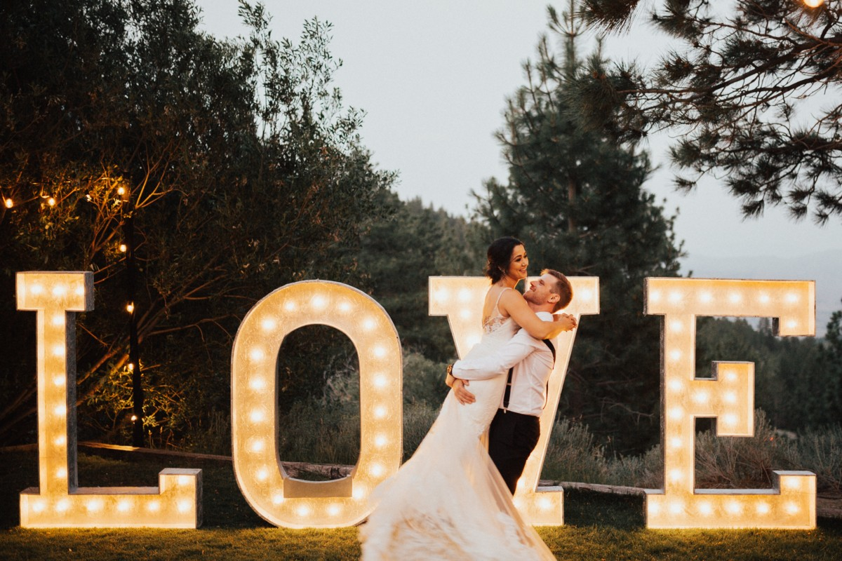 Tannenbaum by Roundabout Lake Tahoe wedding - couple by LOVE sign