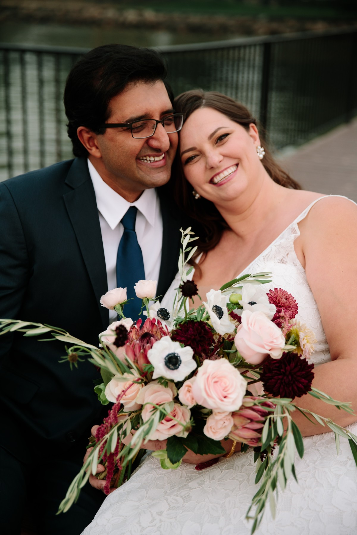 Lake Tahoe florist Create with T - happy couple with bride's bouquet