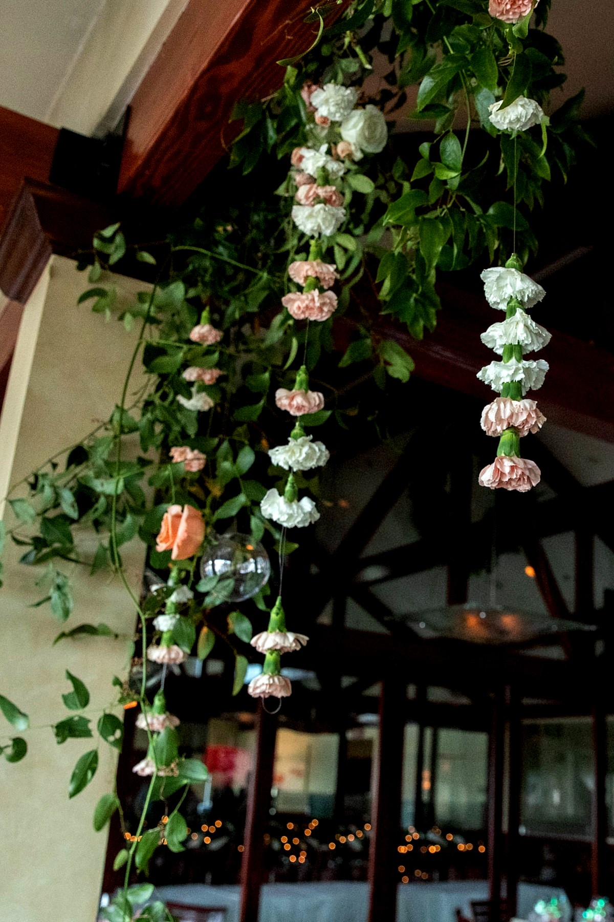 Lake Tahoe florist Create with T - hanging flowers at wedding reception