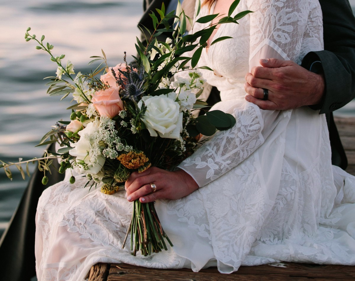 Lake Tahoe florist Create with T - newlyweds relaxing on pier
