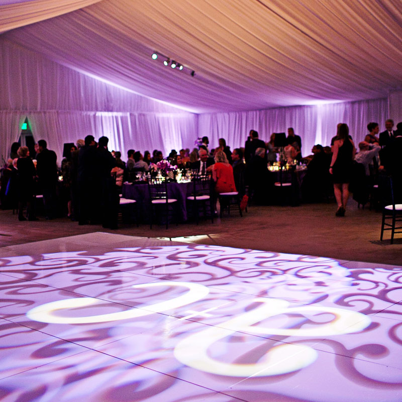 gobo with couple's initials on dance floor at wedding reception