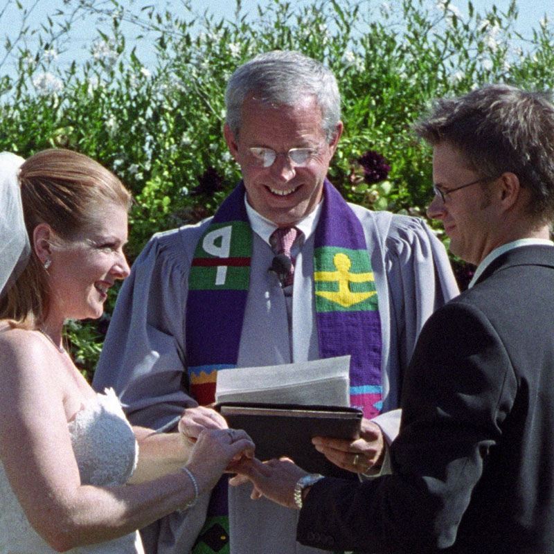 minister officiating at an outdoor wedding