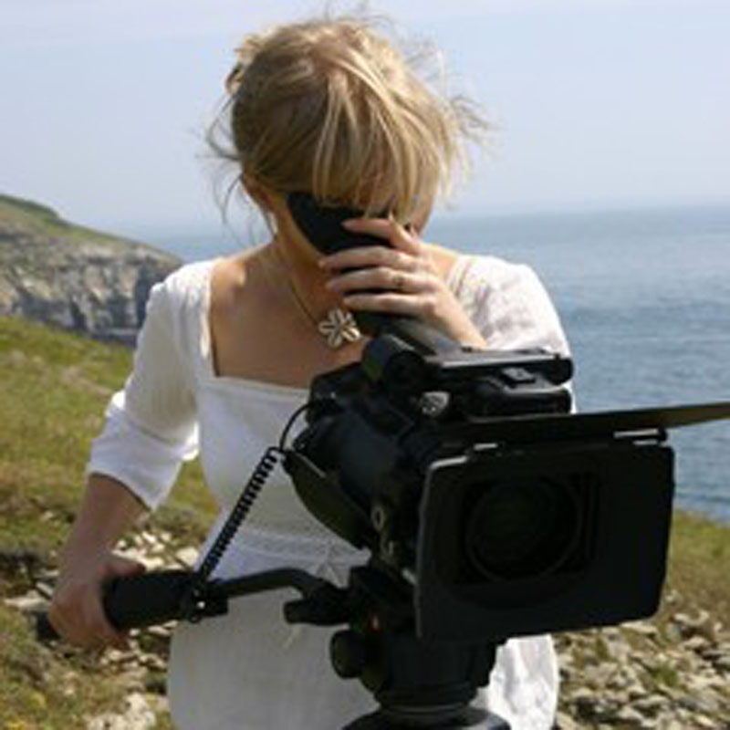 videographer operating video camera