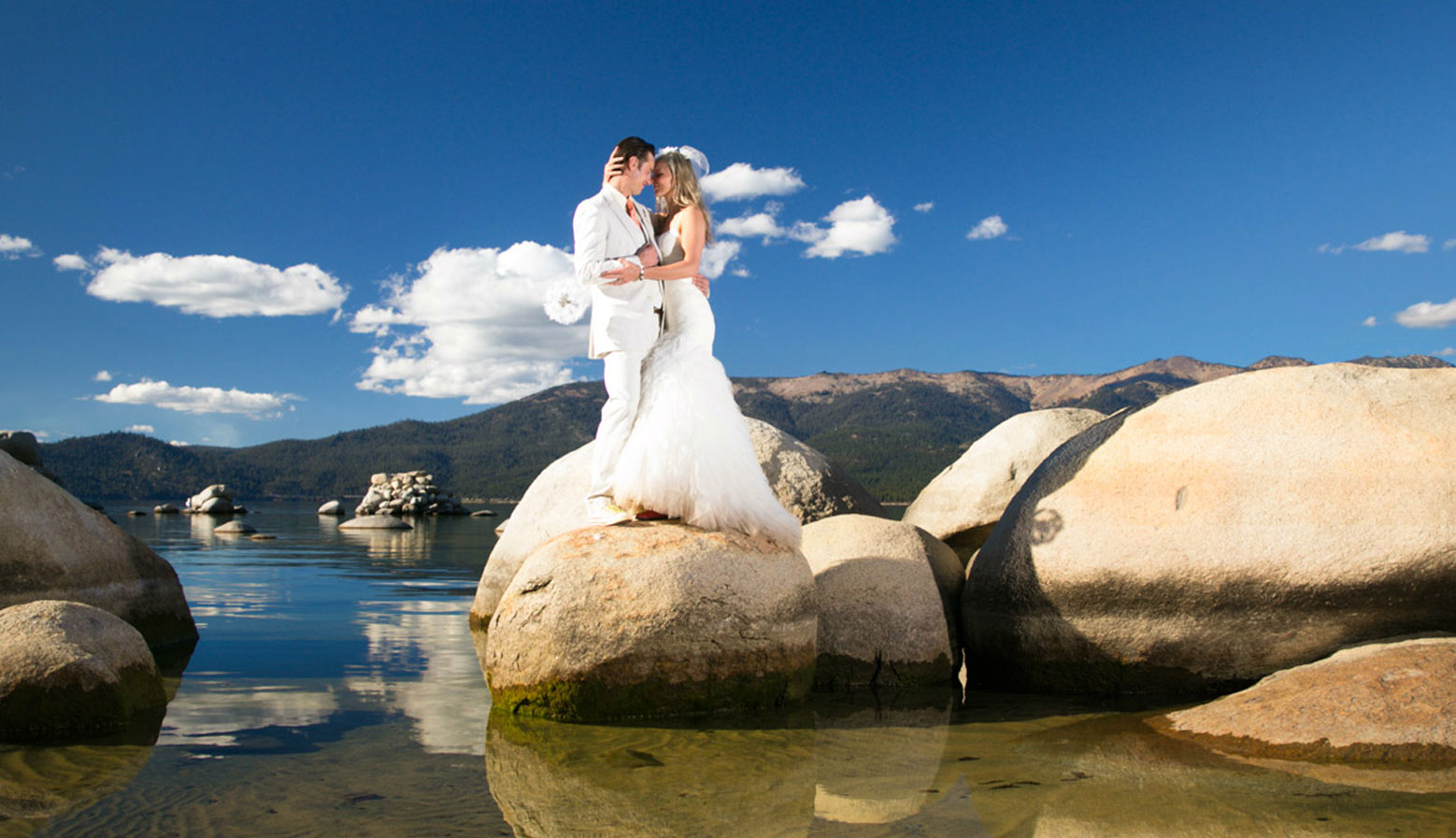 bride and groom by shore of Lake Tahoe